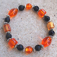 Black and Orange Bracelet by ariaoftherain