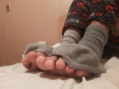 My feet and ripped socks 7