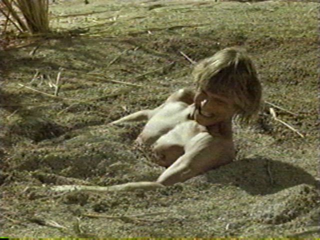 Naked girl stuck in quicksand