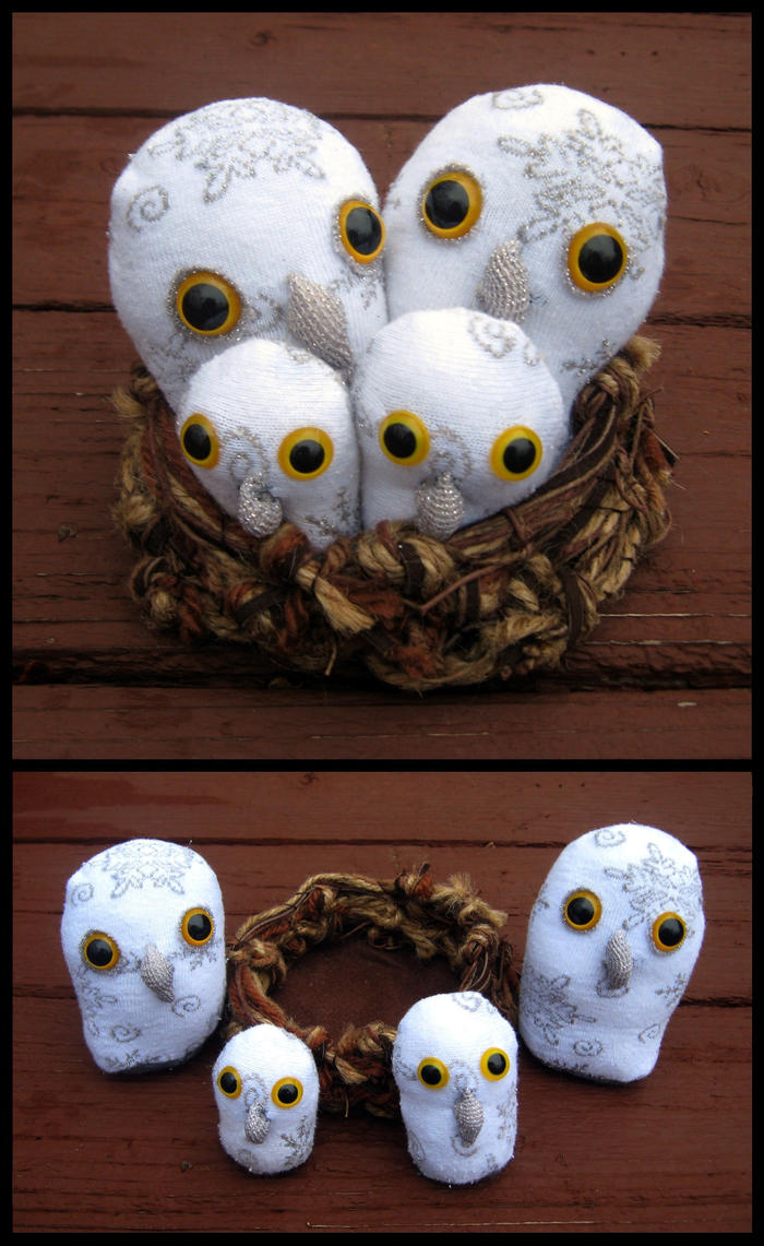 Snow Owl Family by Madelei