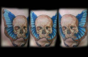 Skull butterfly tattoo by jesserix