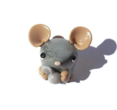Silver clay mouse holding a piece of candy by TrufflesAndTrinketsE