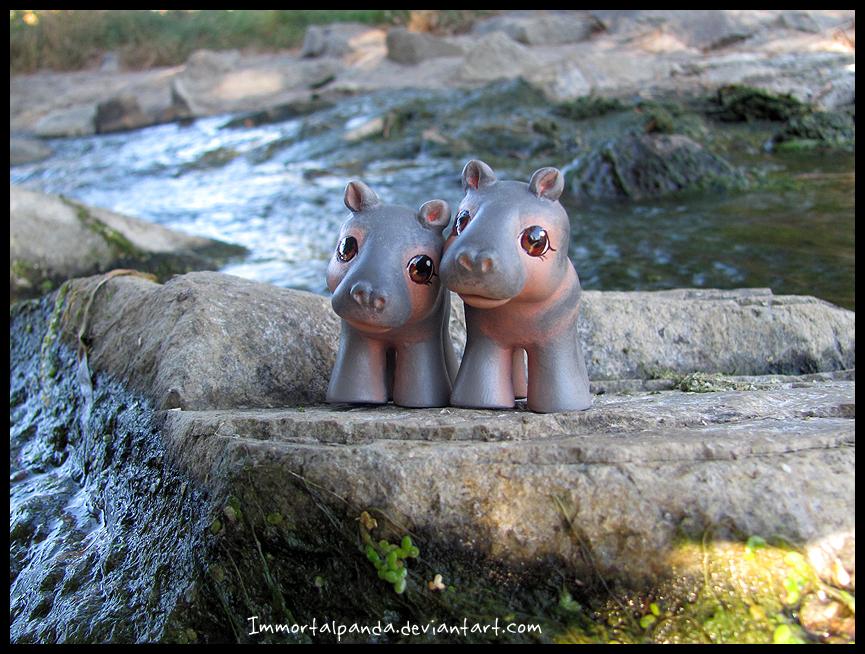 Baby Hippos by ImmortalPanda