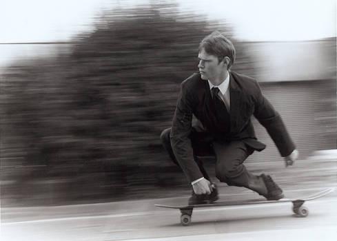 skateboarding businessman