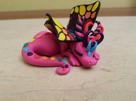 pink butterfly dragon figurine by claymeeples