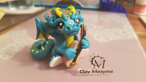 Dragon playing a guitar