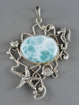 Silver pendant with a big larimar and seahorse