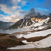 Chaukhi Mountain in clouds. Caucasus, Georgia by Sergey-Ryzhkov