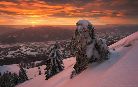 Dramatic fiery sunset in winter Carpathians