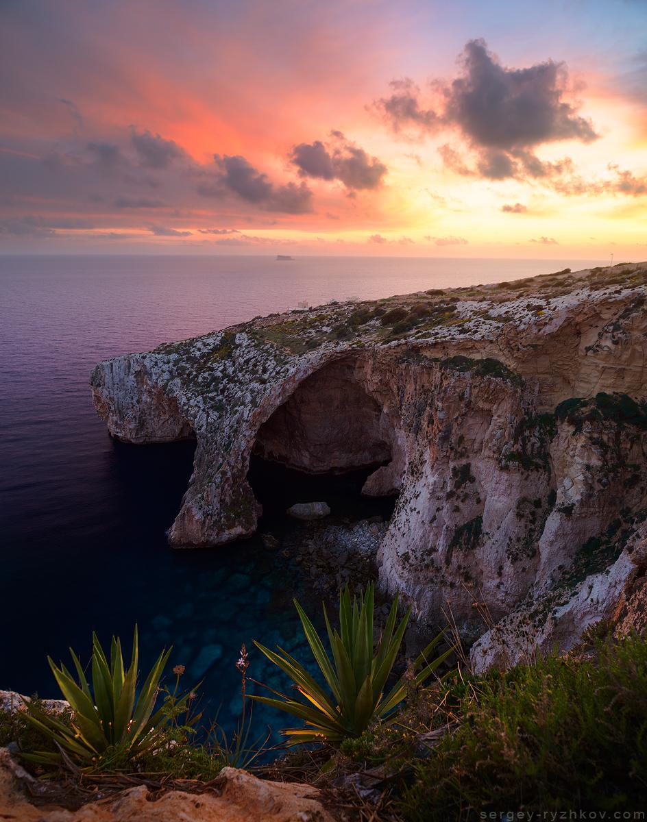 Blue Grotto at sunset, Malta by Sergey-Ryzhkov