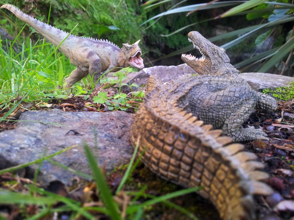 Papo Carnotaurus vs Crocodile by Dark-Hyena