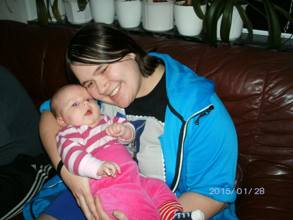 Me holding my cousin's daughter Olivia by KatarinaTheCat