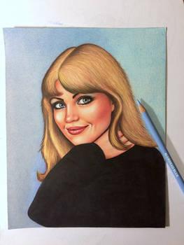 Blue eyes in a black jumper