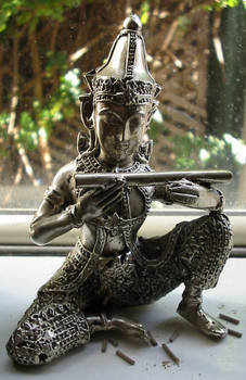 tin buddha statuette