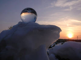 Crystaline sphere on snow pile at sunset 2 by Acrylicdreams