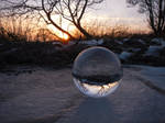 Crystaline sphere on the ice at sunset