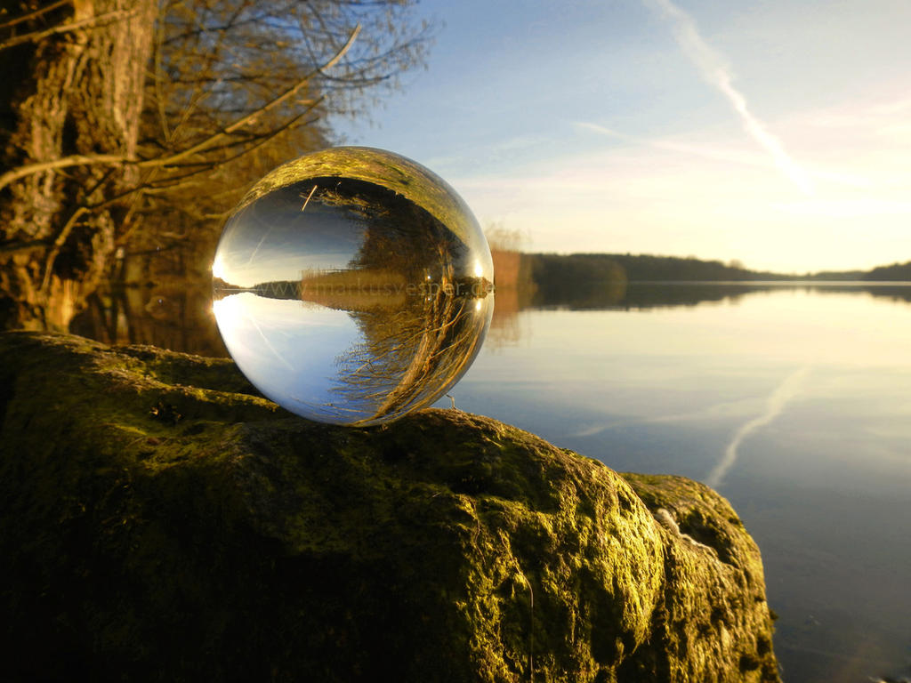 Glass sphere at the lake at sunset by Acrylicdreams