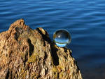 Glass sphere above the water