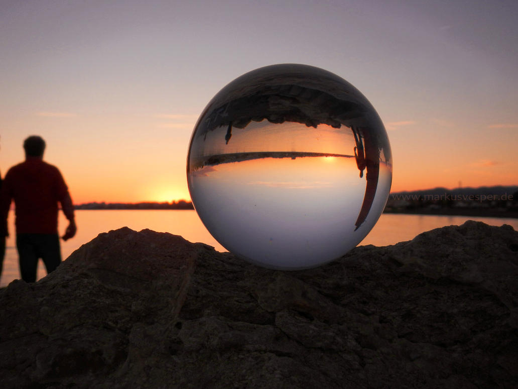 Upside down sunset in crystal ball by Acrylicdreams