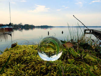 Glass sphere on moss at a lake by Acrylicdreams