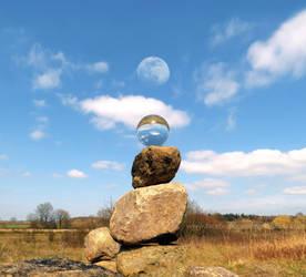 Piled stones + crystal ball