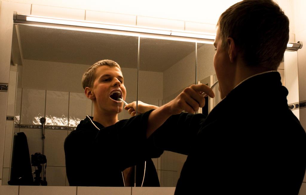 Brushing his teeth