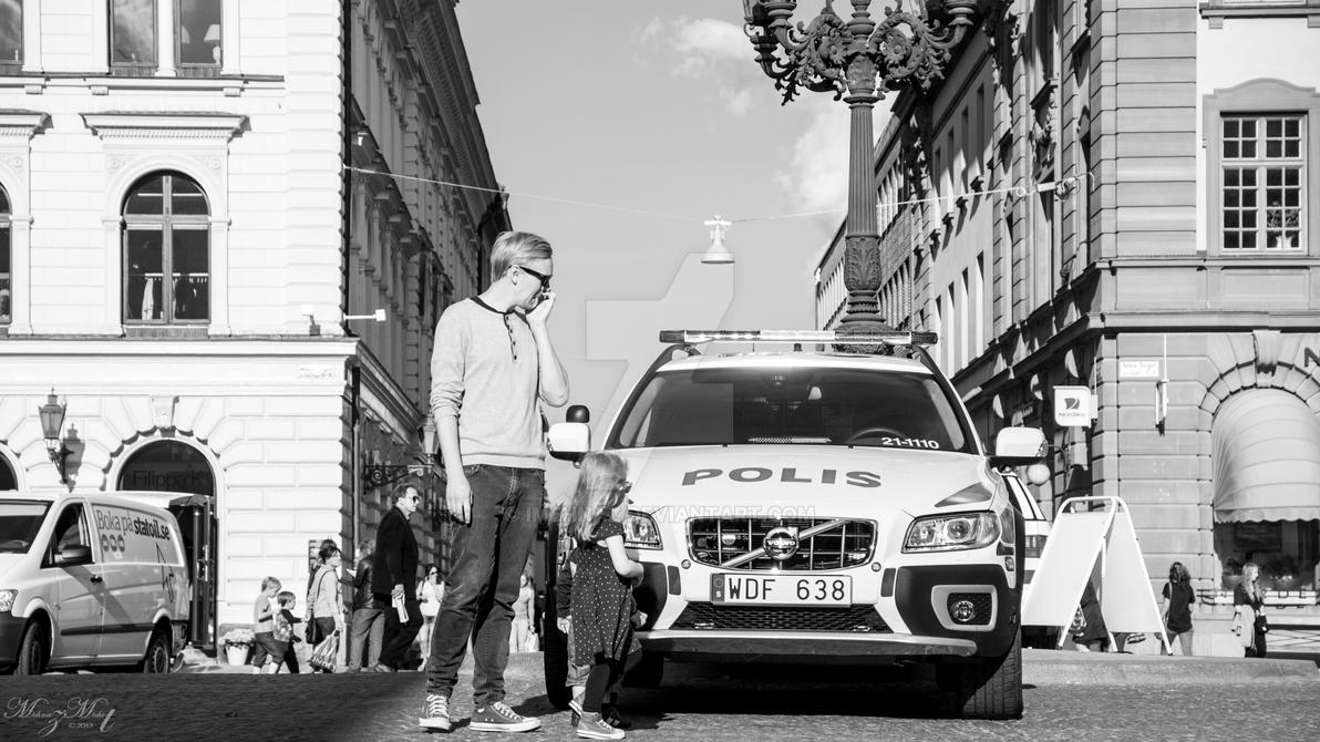 Liitle girl watching a policecar. by iMehnaz