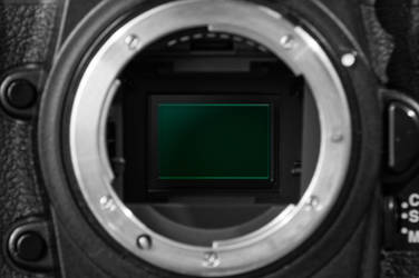 Reflections in a camera eye by Citruspers