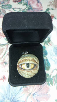 Reptile Eye Pendant by originalwillow