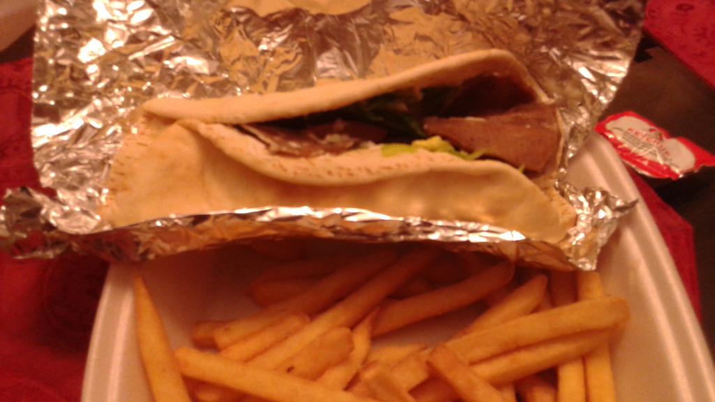 Having a gyro sandwich and fries by mylesterlucky7