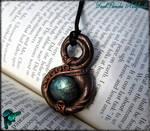 Klein bottle amulet