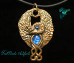 Copper phoenix with blue dichroic heart by TealpandaArtifacts