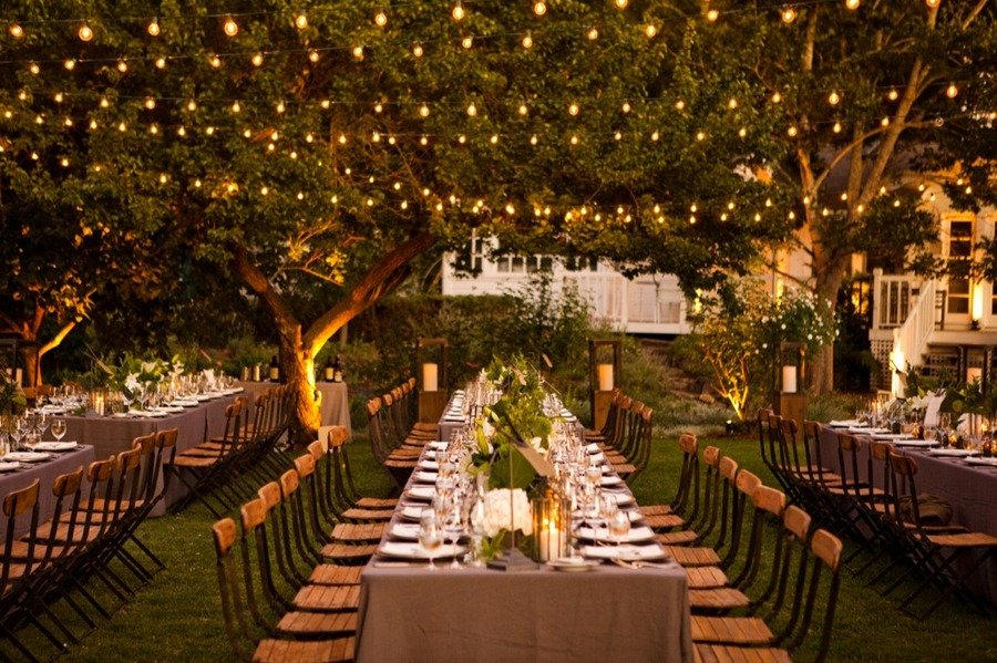Wedding table with string light at the backyard