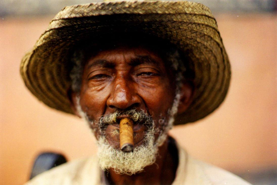 Old Man Smoking by Leonida