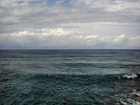 Stock Photo: blue ocean background with clouds