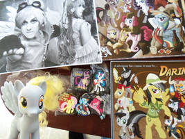 Derpy loves posters and charms by tygerbug