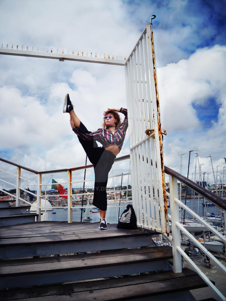 Practising yoga in marina of Cascais, Portugal by Nyrey