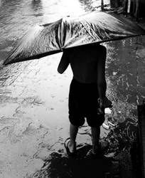The Kid on a rainy day by softhunterdevil