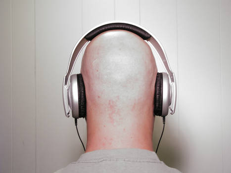 Bald man wearing Headphones 2
