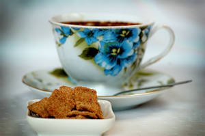 Cup of coffee and cinnamon squares