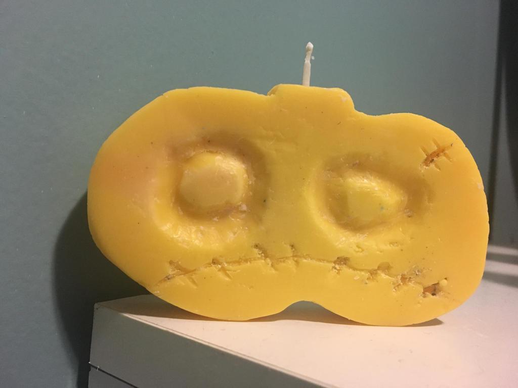 Zombie Pumpkin Magisword Candle by Sorehoof