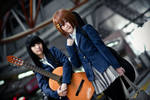 Mio and Yui from K-ON catching a train