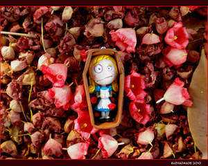 FIMO Alice in Death on flowers