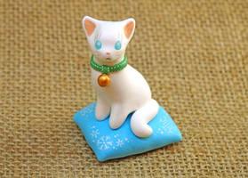 A White Cat on a blue Pillow by Ailinn-Lein