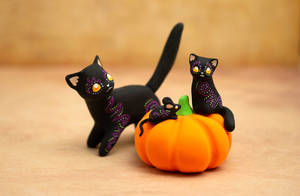 Two Cats, a Mouse and a Pumpkin
