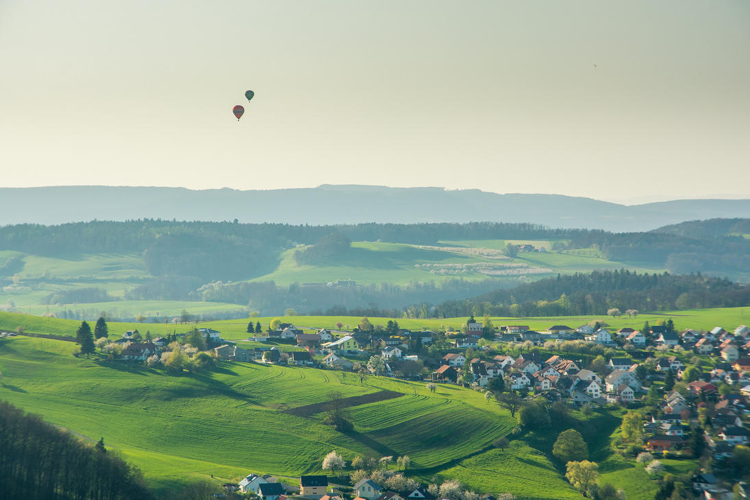 Balloons over the village by Jufington