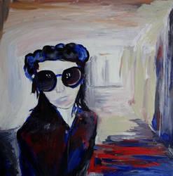 Person mit Sonnenbrille und Baskenmtze
