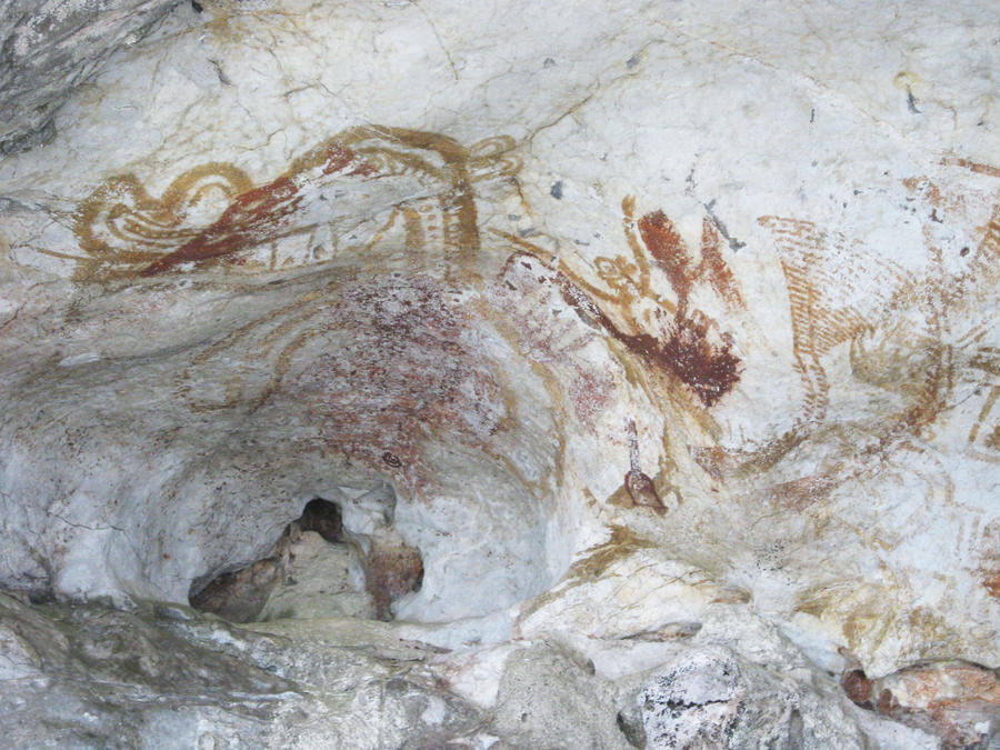 Ancient cave paintings dinosaurs