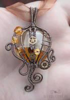 Amber yellow steampunk pendant by ukapala