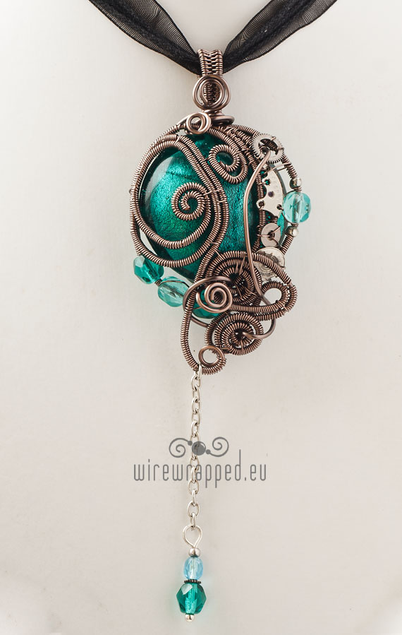 Teal round steampunk pendant by ukapala